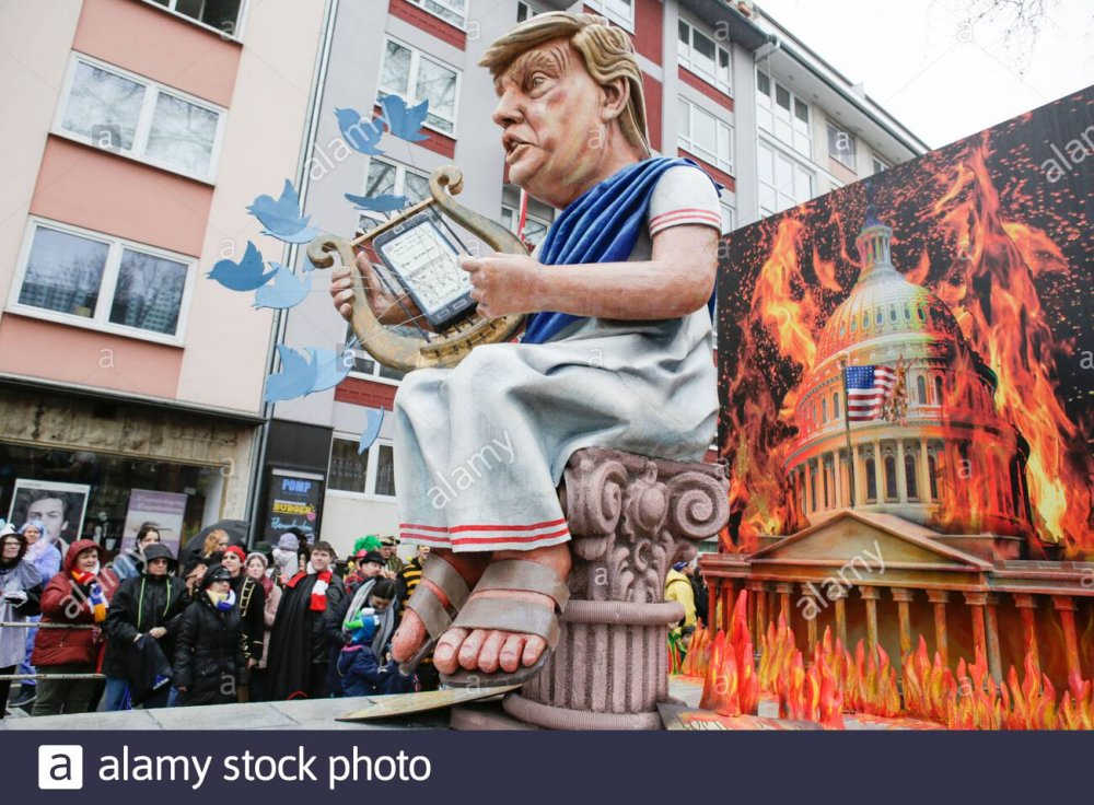 The US President Donald Trump is depicted as Roman Emperor Nero, on a float  in the Mainz Rose Monday parade. He sits in front of a burning United  States Capitol, twittering on