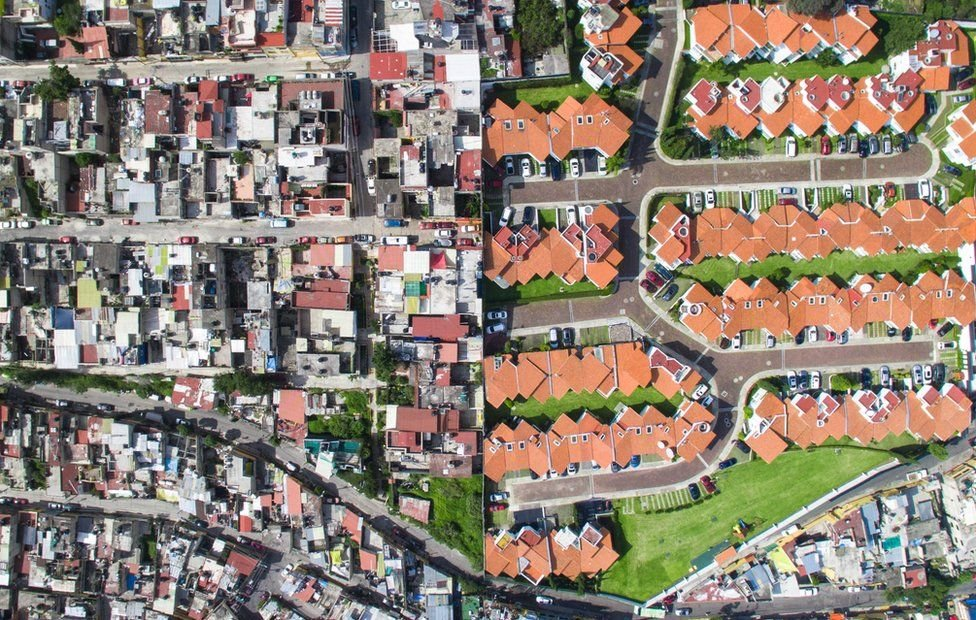 Aerial photos reveal the stark divide between rich and poor - BBC News