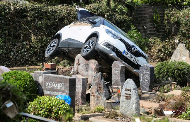 Slide 5 of 28: A car rests in a cemetery following flooding in Dernau, Germany, on July 17, 2021.