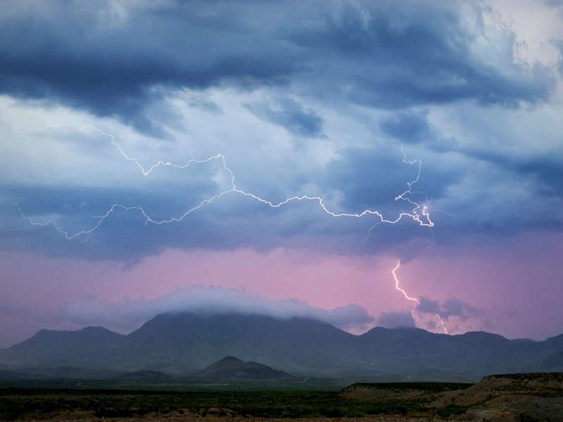 a group of clouds in the sky: Monsoon thunderstorm pictured on July 29, 2017 in Safford, Arizona. Barcroft Media via Getty Images