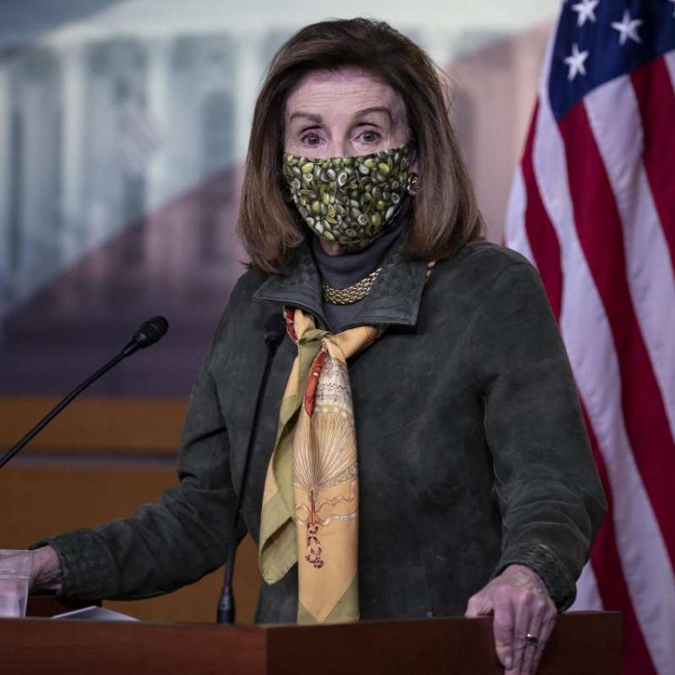 a person wearing a costume: Speaker Pelosi Holds Weekly News Conference On Capitol Hill