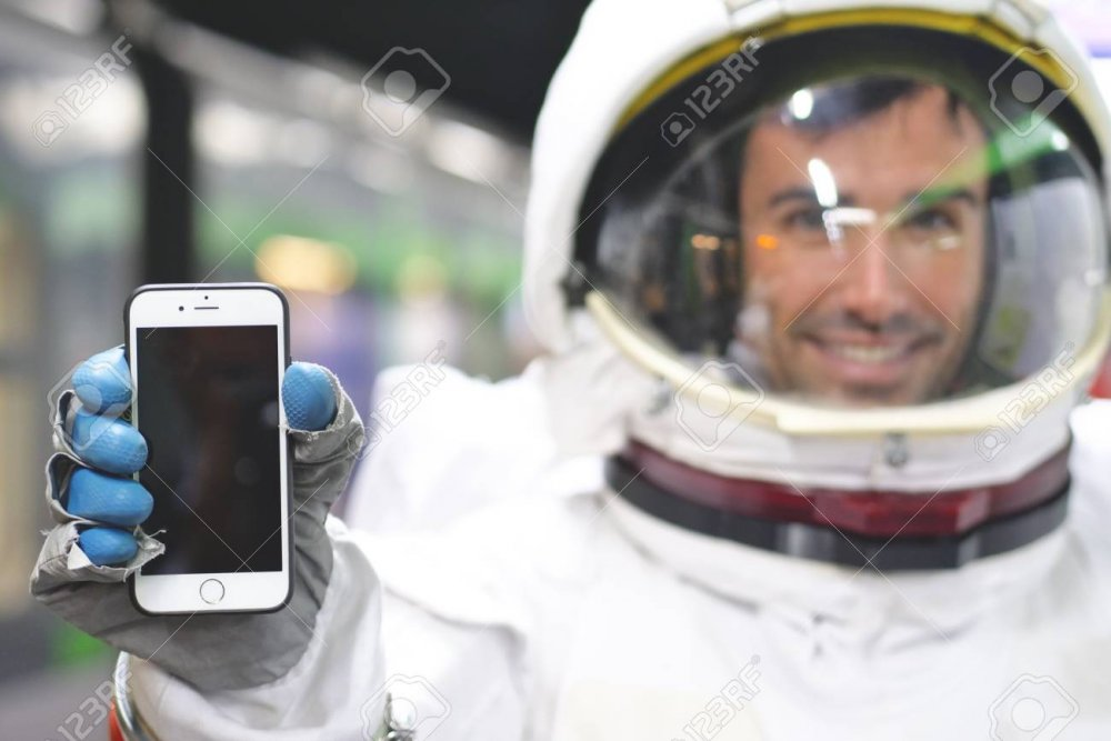 An Astronaut Dressed In The Smartphone To Call And Send Messages ...
