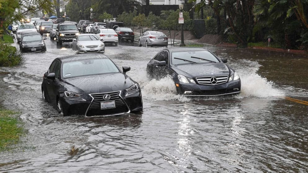 PHOTO: Cars drive through a flooded street after a storm dumped heavy rain on Los Angeles, Feb. 2, 2019.