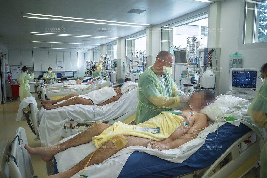 0009-2020-03-25-Switzerland-Ticino-Lugano-Health-Hospital-Clinica-Moncucco-Intensive-Care-Unit-Nurses-Patient-Coronavirus-Naked-Body.jpg